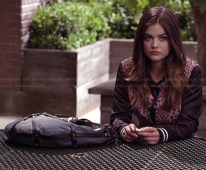 Aria's pink leopard bomber jacket and blue strappy bag on Pretty Little Liars