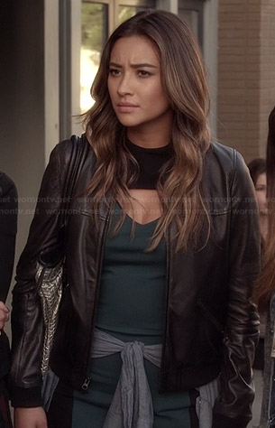 Emily's teal green bodycon dress with cutout chest, leather jacket and silver bag on Pretty Little Liars