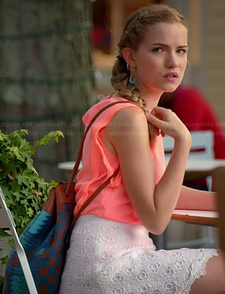 Emma's neon orange top with ruffle sleeves and blue printed backpack on Royal Pains