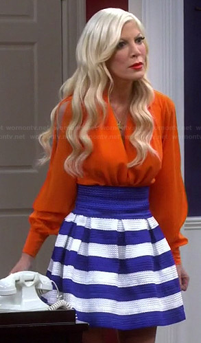 Holly's blue wrap blouse and blue striped skirt on Mystery Girls