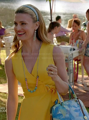Paige's yellow belted wrap dress and blue floral bag on Royal Pains
