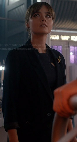 Clara's navy blazer and beaded brooch on Doctor Who