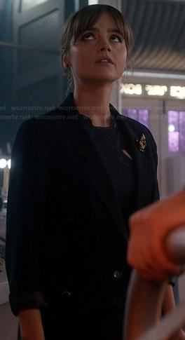 Clara's navy blazer and beaded brooch on Doctor Who