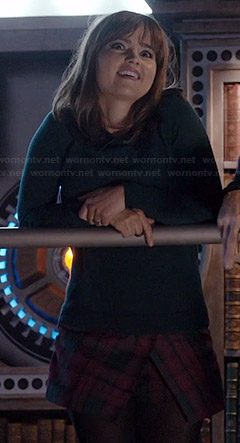 Clara's plaid asymmetric skort and green sweater on Doctor Who
