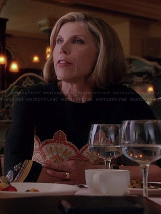 Diane's black and orange printed dress on The Good Wife