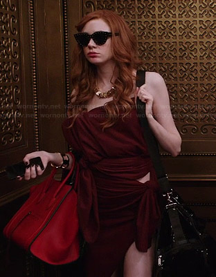 Eliza's studded sunglasses and red bag on Selfie