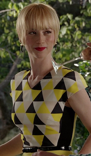Margaux's yellow triangle print dress and black horn earrings on Revenge