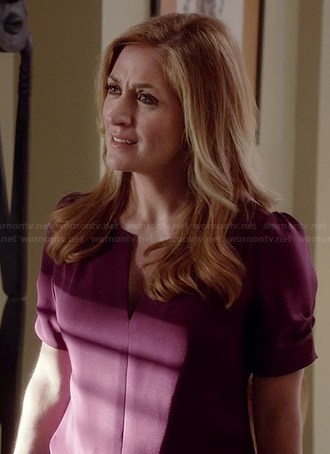 Maura's purple split neck blouse with ruched sleeves on Rizzoli and Isles