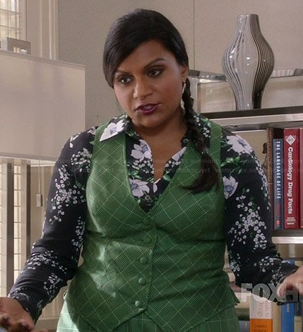 Mindy's black floral long sleeve blouse and green checked vest and skirt on The Mindy Project