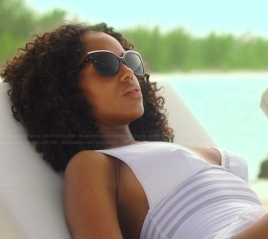 Olivia's white sheer striped swimsuit and black and white sunglasses on Scandal
