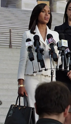 Olivia's white jacket with cutout hem and black Prada bag on Scandal