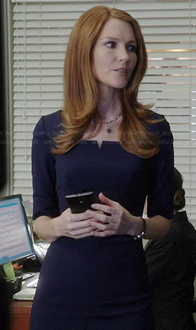 Abby's navy blue split neck dress on Scandal