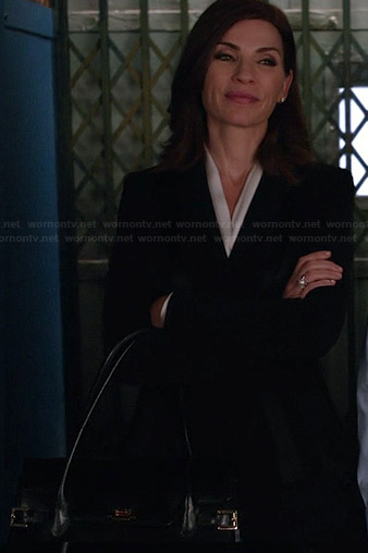 Alicia's black handbag with buckles on The Good Wife