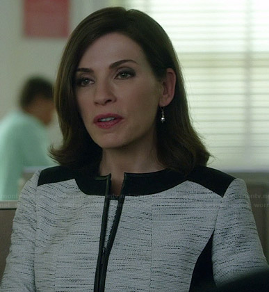 Alicia's white tweed jacket with black trim on The Good Wife