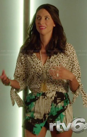 Amy's white cheetah print blouse and green abstract printed skort on Manhattan Love Story
