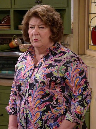 Carol's multi-colored paisley shirt on The Millers