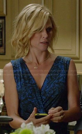 Claire's blue printed wrap dress on Modern Family