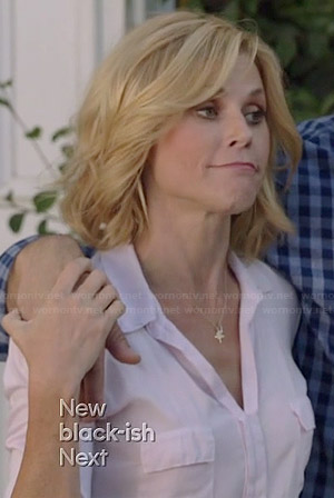 Claire's white flap pocket top on Modern Family