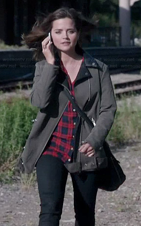 Clara's army green biker coat with leather lapel, red plaid shirt and high top sneakers on Doctor Who