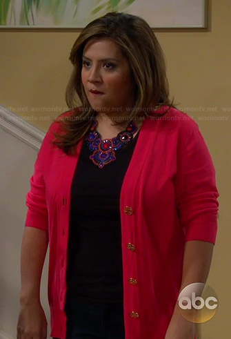 Cristela's red cardigan and studded slide flats on Cristela