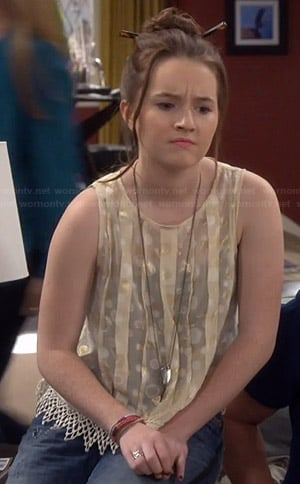 Eve's gold pleated polka dot top on Last Man Standing