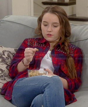 Eve's red plaid shirt with grommets on Last Man Standing