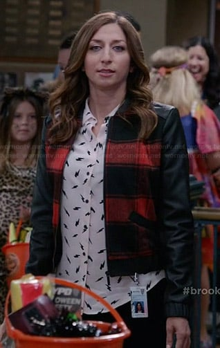 Gina's lightning bolt print shirt and red checked bomber jacket with leather sleeves on Brooklyn Nine-Nine