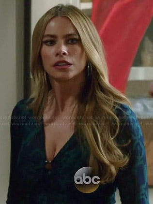 Gloria's blue and green snake print top on Modern Family
