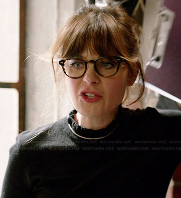 Jess's black ruffled neck top on New Girl