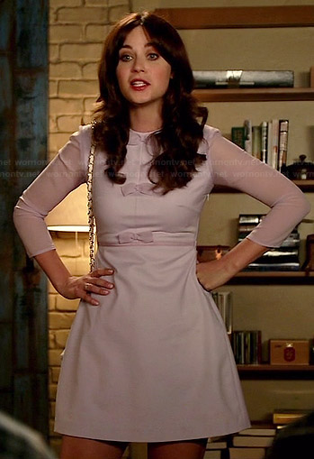 Jess's purple bow front dress with sheer sleeves on New Girl