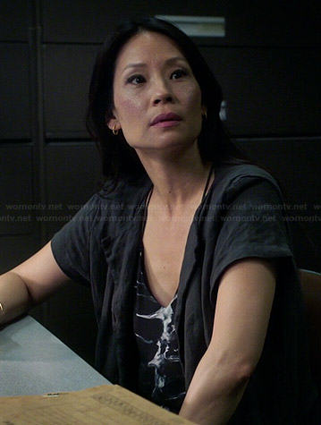 Joan's dark grey short sleeved long jacket on Elementary