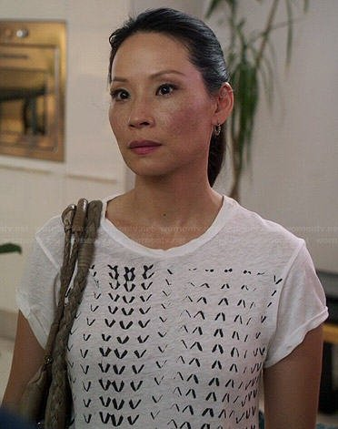 Joan's white chevron printed tee on Elementary