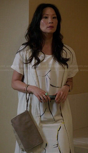 Joan's white crack painted t-shirt dress and white short sleeved long cardigan on Elementary