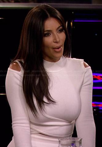 Kim Kardashian's white cutout cropped sweater and skirt on 2 Broke Girls