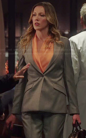 Laurel's orange blouse and grey blazer on Arrow