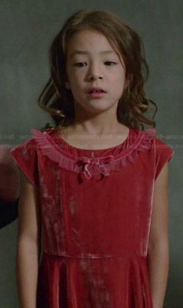 Lily's red velvet bow dress on Modern Family