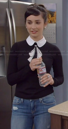 Mandy's black and white collared bow sweater on Last Man Standing