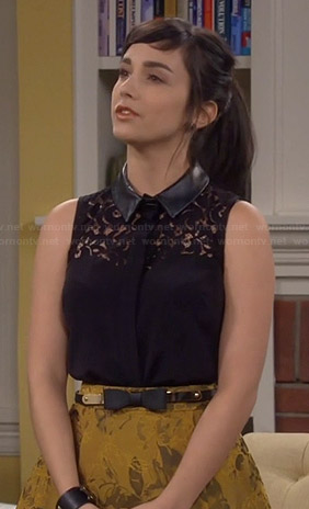 Mandy's black lace top with leather collar and gold skirt on Last Man Standing