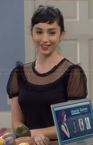 Mandy's black sheer polka dot panel top on Last Man Standing