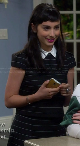 Mandy's black striped top with collar and matching skirt on Last Man Standing