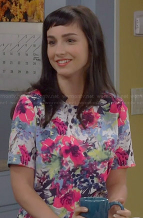 Mandy's bright floral print top with zip back on Last Man Standing