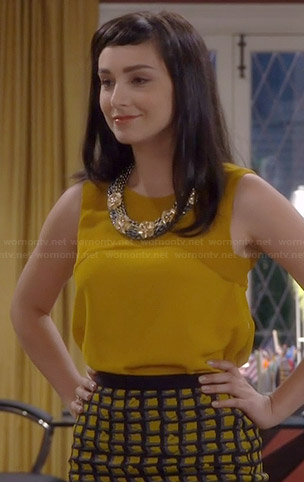 Mandy's yellow checked skirt and sleeveless top on Last Man Standing