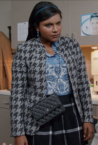 Mindy's grey houndstooth jacket, blue printed shirt and checked skirt on The Mindy Project