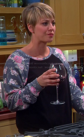Penny's black sweatshirt with floral sleeves on The Big Bang Theory