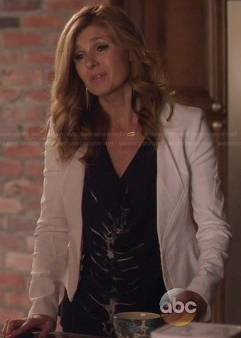 Rayna's black skeleton graphic blouse and white jacket on Nashville