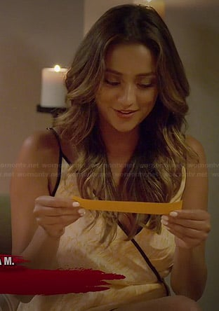 Shay Mitchell's orange wrap dress with black trim on Pretty Little Liars