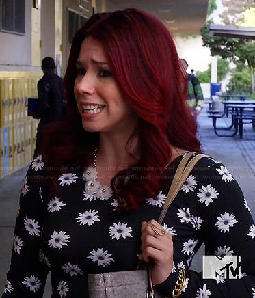 Tamara's black daisy print long sleeve top on Awkward