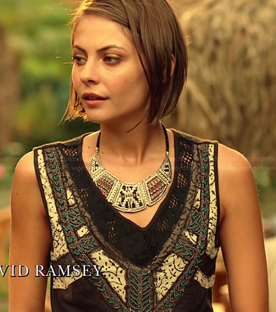 Thea's black embroidered crossover top and bib necklace on Arrow