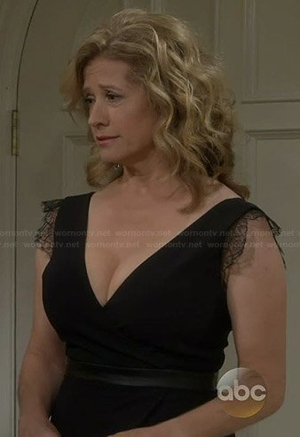 Vanessa's black wrap dress with leather trim and lace sleeves on Last Man Standing