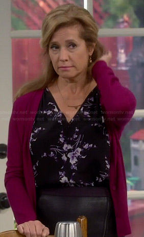 Vanessa's black and purple floral v-neck top on Last Man Standing